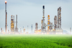 Oil,Refinery,In,Green,Fields,And,The,Mists
